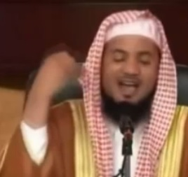 Muhammad Ali Shanqiti demonstrating the vertical hand motion he performs when contemplating the virgins in Islamic heaven