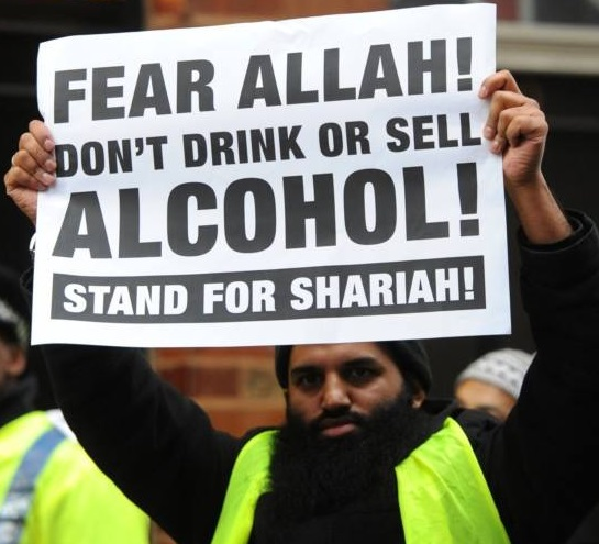 Even with beer goggles, that is one fugly Muslim!