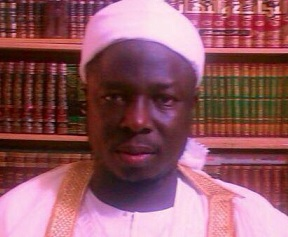 Aminu Ibrahim Daurawa in front of a massive collection of child-porn literature