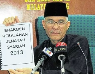 Wan Abdul Wahid bin Wan Hassan proudly clutching a sharia-based legal document