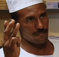 Al Samani al Hadi Mohamed Abdullah likely demonstrating a bizarre sexual technique performed with his fingers