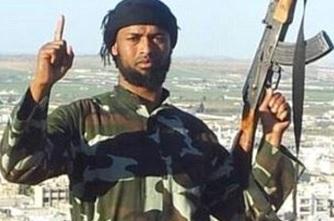 Abdirahmaan Muhumed holding a Magic Muslim Peace Sprayer™