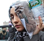 Ailina Tsarnaeva trying to impersonate Lana Del Rey while wearing a perennially-out-of-fashion leopard-ish print hijab