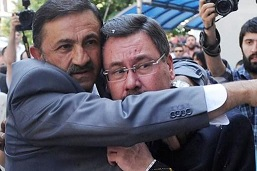 The bespectacled Ibrahim Melih Gökçek cowering when confronted in the real world