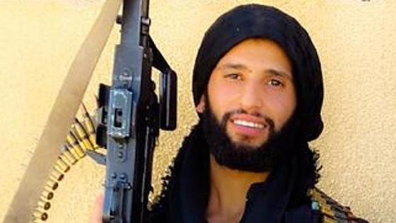 Mahmoud Abdullatif with a Magic Muslim Peace Sprayer™
